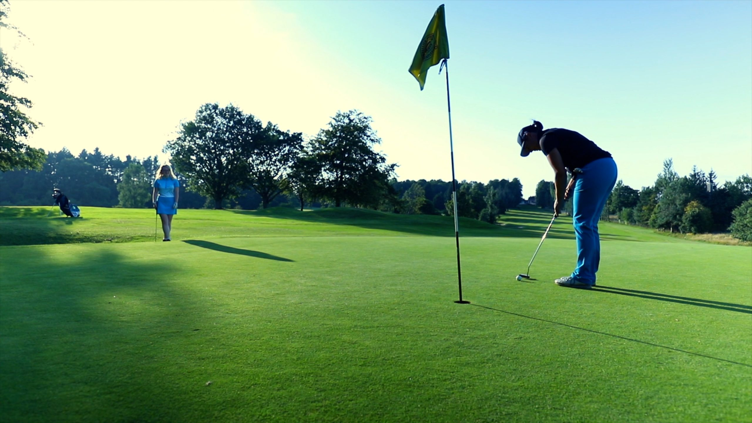 players playing golf